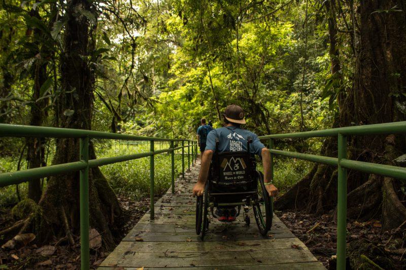 Person on a wheelchair on a wheelchair accessible trail in Costa Rica